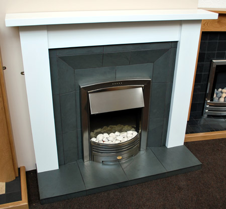Grey slate splayed fireplace
