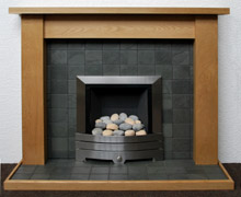 Grey riven slate hearth and panel