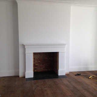 Bespoke whte fire surround