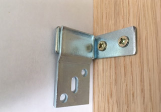 Fire surround fixing brackets